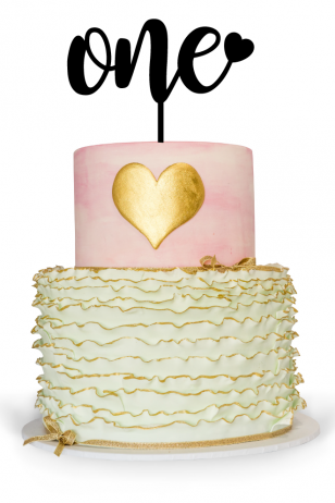 First Birthday Cake Topper on top of birthday cake