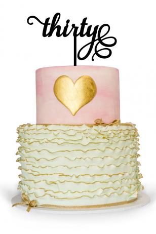 30th birthday cake topper on top of birthday cake